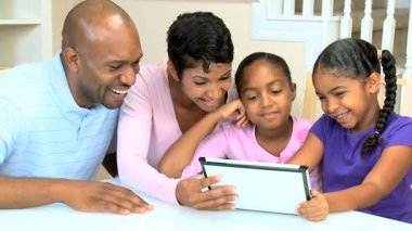 Young Parents Watching Children Using Wireless Tablet — Stock Video