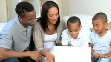 Ethnic Parents Watching Young Sons Using Laptop — Stock Video