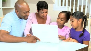 Proud Ethnic Parents Watching Daughters Using Laptop — Stock Video