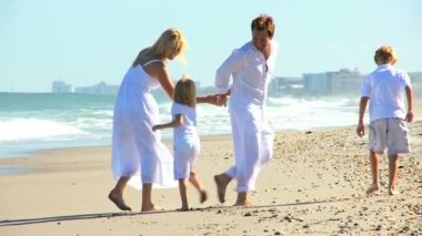 Young Caucasian Family Beach Fun — Stock Video