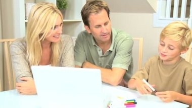 Young Blonde Boy with Parents Using Color Pens — Stock Video