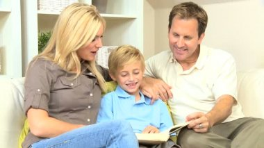 Young caucasian family sharing a book — Stock Video