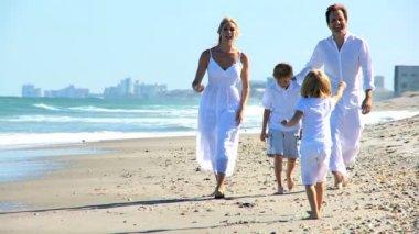 Happy Caucasian Family Walking on Beach — Stock Video