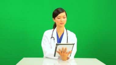 Asian Chinese Female Doctor Green Screen Tablet — Stock Video