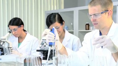 Medical Research Students in Laboratory — Stockvideo