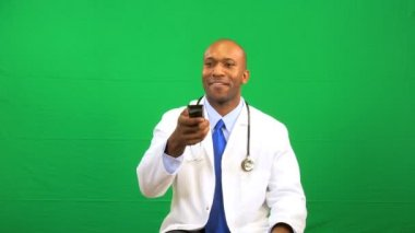 Male Ethnic Doctor Remote Green Screen Technology — Stock Video