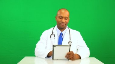 Ethic Male Doctor Wireless Tablet Green Screen — Stock Video