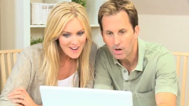 Blonde Couple Pleased with Laptop Online Success — Stock Video