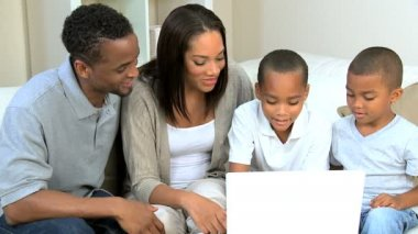 Ethnic Parents Watching Sons Using Laptop — Stock Video