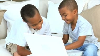 Cute Ethnic Brothers with Laptop Computer — Stock Video