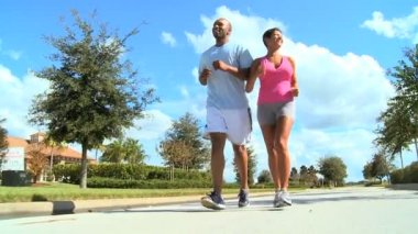 Young Running Partners on Suburban Roads — Stock Video
