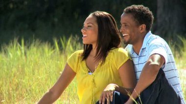 African American Couple Sitting in Park — Stock Video
