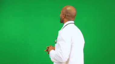 Male Ethnic Doctor Pleased Green Screen Demonstration — Stok video