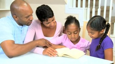 Little Ethnic Girl Reading with Family — Stock Video
