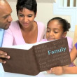 Stock Video: AfricAmericFamily with Photograph Album