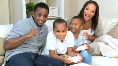 Ethnic Family Playing Handheld Electronic Gamea — Stock Video