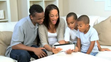 Young Boys and Their Parents With a Wireless Tablet — Stock Video