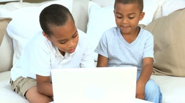 Cute Young Ethnic Boys with Laptop — Stock Video