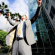 Businessman Triumphant Outside City Buildings — Stock Video