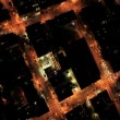 Aerial night vertical city view of rolling road grid system, USA - Stock Photo
