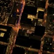 Aerial night illuminated vertical view of rolling roads city traffic, USA — Stock Video