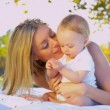 Stock Video: Beautiful Mother and Young Child Outdoors