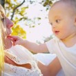 Royalty-Free Stock Imagem Vetorial: Blonde Mom and Baby Together Outdoors