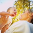 Blonde Mom and Baby Laughing Outdoors — Stock Video #23704239