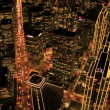 Aerial night view of skyscrapers and streets, Metropolis, USA - Stock Photo