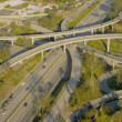 Stock Video: Aerial elevated road system suburbs, USA