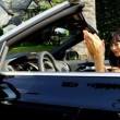 Stock Video: Girls Singing Laughing in Luxury Convertible