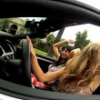 Stock Video: Beautiful Girls Waving Arms Driving Convertible Car