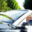 Blonde and Brunette Girls in Luxury Car — Stock Video #23704715