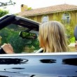 Suntanned California Girls Driving in Luxury - Stock Photo