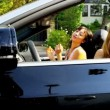 Young Girls Driving in Open Top Car — Stock Video #23705221