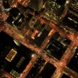 Aerial night vertical view of skyscraper rooftops, USA — Stock Video