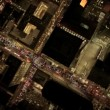 Stock Video: Aerial night vertical view of skyscrapers in a Metropolis, USA