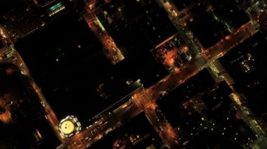 Aerial night vertical rooftop view of city buildings and traffic, USA — ストックビデオ