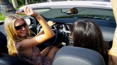 Young Girls Driving in Open Top Car — Stock Video