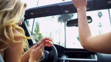 Girls in Sunglasses Driving Convertible — Stock Video