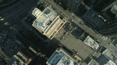 Aerial vertical view of rooftop city buildings, USA — Stock Video