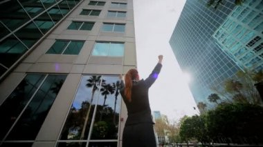 Businesswoman Triumphant Outside City Buildings — Stock Video