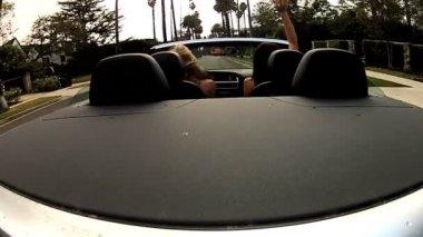 Suntanned California Girls Driving in Luxury — Stock Video