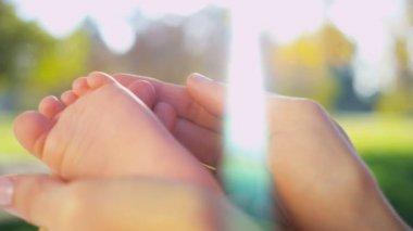 Hands Cradling Baby Foot in Close up — Stock Video