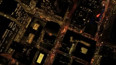 Aerial night vertical rooftop view of city skyscrapers, USA — Vídeo de stock
