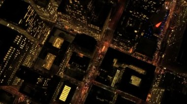 Aerial night vertical rooftop view of city skyscrapers, USA — Video Stock