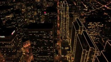 Aerial night view of illuminated city skyscrapers, USA — Stock Video