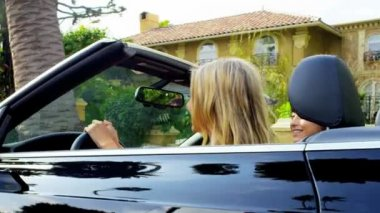 Suntanned California Girls Driving in Luxury — Stock Video