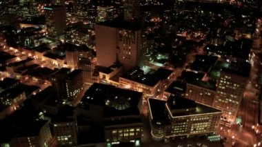 Aerial night illuminated view of city blocks and streets, America — Stock Video