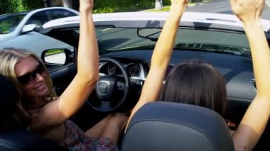Girlfriends on Vacation Driving Open Top Car — Stock Video #23705345
